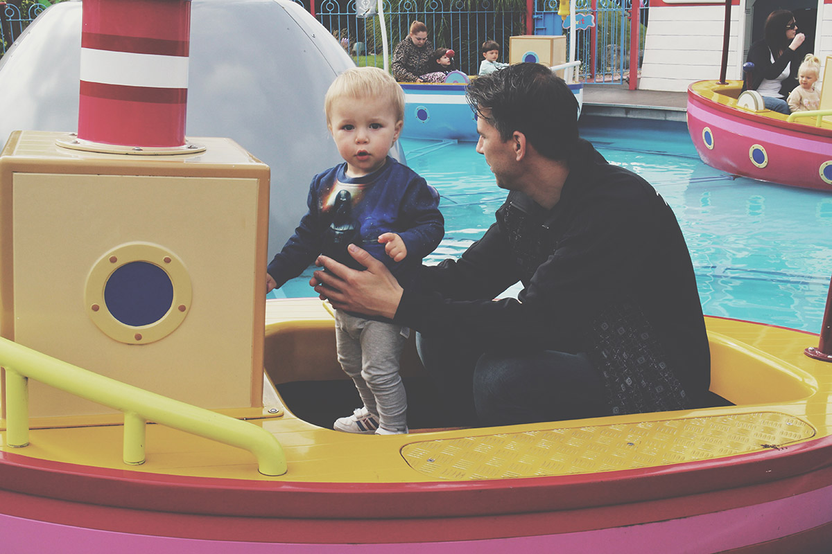 The Ultimate Toddlers Day Out at Peppa Pig World - Toddler standing on boat water ride
