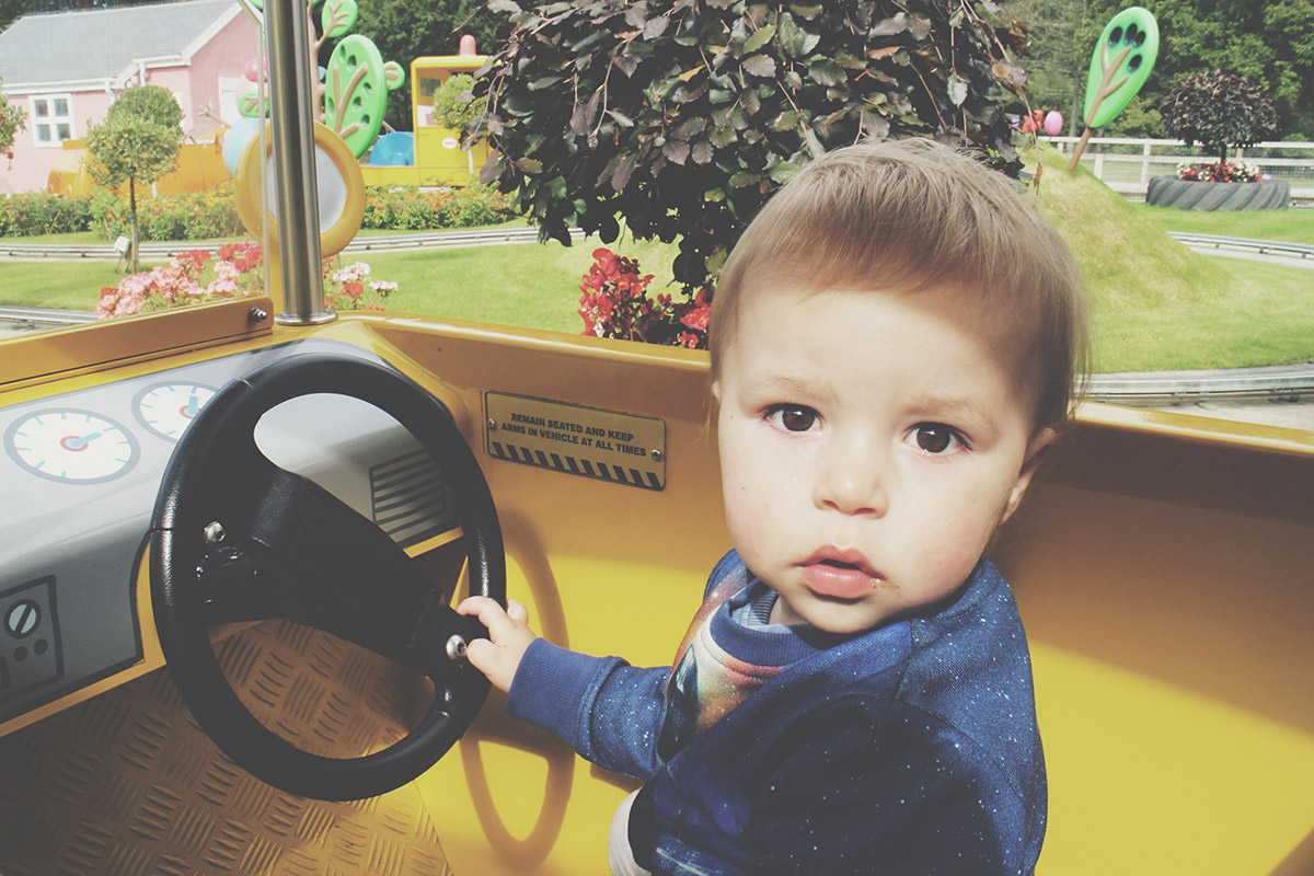 The Ultimate Toddlers Day Out at Peppa Pig World - Toddler sitting in car ride