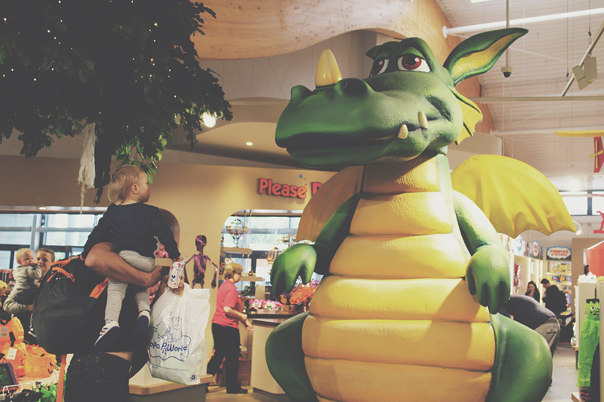 The Ultimate Toddlers Day Out at Peppa Pig World - Toddler pointing at large dragon